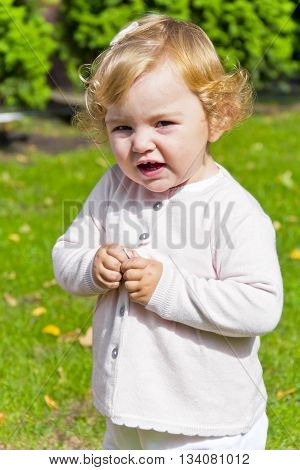 Cute baby girl with curly blond hair