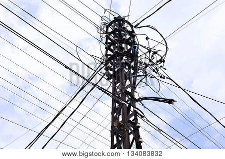 Old metal electric pole and a plurality of electrical wires