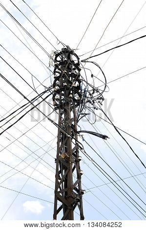 Many wires on an old electric pole.