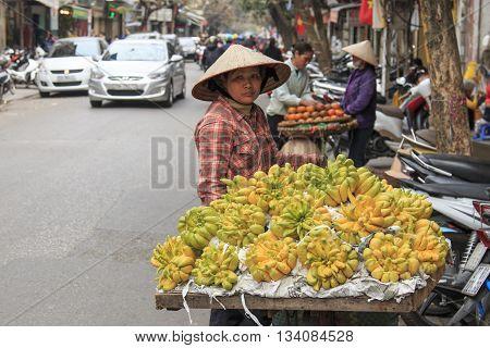 Hanoi Vietnam: February 20 2016: Woman selling Buddha's hand Lemons in a street of Hanoi