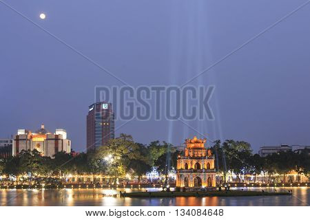 Hanoi Vietnam - 21 February 2016: Night view of the Hoan Kiem Lake (Lake of the Returned Sword) and the Turtle Tower with full moon.