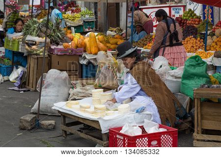 La Paz, Bolivia - October 24, 2015: Woman selling cheese on the street market.
