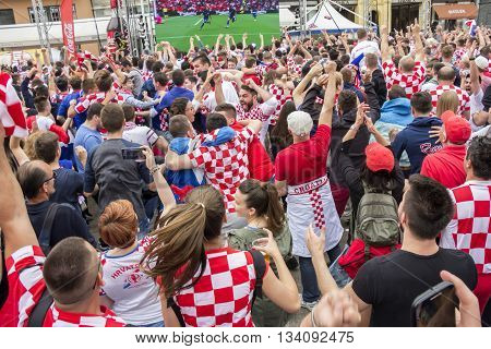 ZAGREB, CROATIA - JUNE 12 Croatian football fans on the Ban Jelacic Square, watching EURO 2016 match Turkey vs Croatia on June 12, 2016 in Zagreb, Croatia