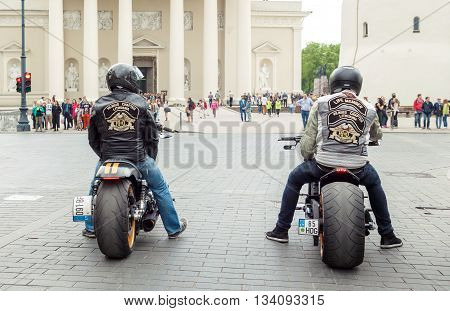 VILNIUS LITHUANIA - MAY 21 2016: Two riders sitting on Harley-Davidson bikes and waiting for green light on the street in Vilnius Lithuania.
