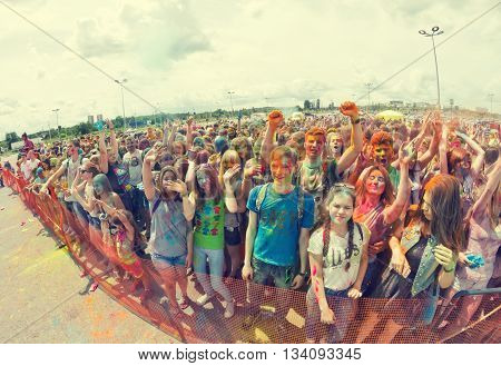 A Crowd Of Young Men With Painted Faces On The Colorfest