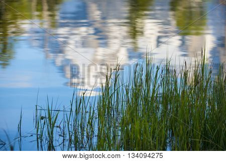 Reflected beautiful rugged rocky Teton snow capped mountain range blue sky majestic landscape scene in water