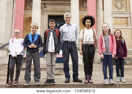Portrait Of Teacher With Class Standing Outside Museum