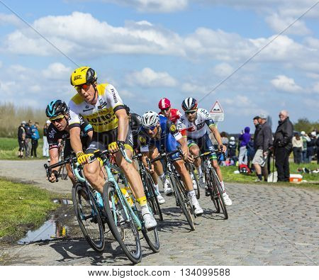 Hornaing France - April 10,2016: The Belgian cyclist Tom Boonen of Etixx-Quick Step Team riding in the peloton on a paved road in Hornaing France during Paris Roubaix on 10 April 2016.