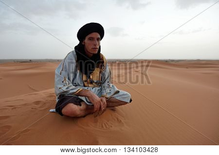 SAHARA MOROCCO - AUGUST 03: Unidentified bedouin man wears traditional clothing in Sahara desert in Morocco August 03 2015. The Sahara is the largest hot desert.