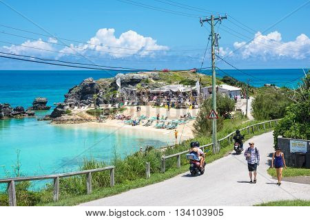 ST.GEORGE BERMUDA MAY 27 - Tourists on the road overlooking Tobacco Bay a beautiful secluded beach on May 27 2016 in Bermuda.