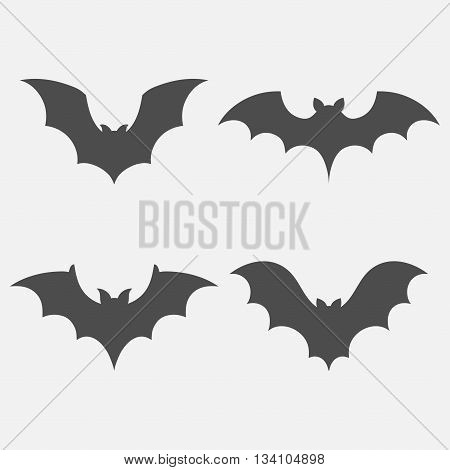 Bats vector set isolated on white background. Dark silhouettes of bats flying in a flat style. Simple icons of bats for Halloween.