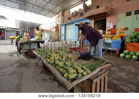 RISSANI MOROCCO - AUGUST 03: Unidentified people trades fresh fruits in market in Rissani Morocco August 03 2015. Rissani is a town in eastern Morocco located near Erfoud.