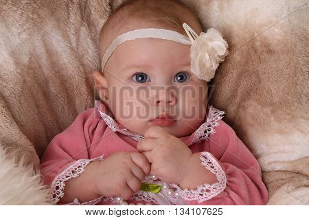 Beautiful Baby girl with flower headband looking