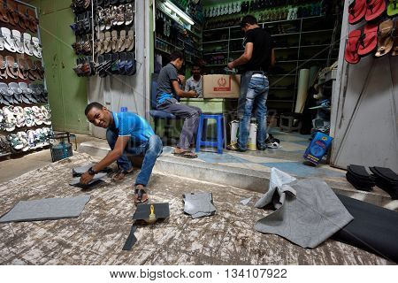 RISSANI MOROCCO - AUGUST 03: Unidentified people making shoes in a market in Rissani Morocco August 03 2015. Rissani is a town in eastern Morocco located near Erfoud.