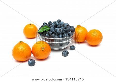 ripe tangerines and blueberries on a white background. horizontal photo.
