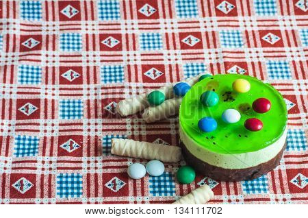 Sweet cake with kiwi. Colorful sweet, very sweet and attractive. Saturated colors. Birthday Cake. Kiwi Cake.