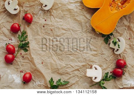 Vegetable frame on parchment background. Top view, flat lay