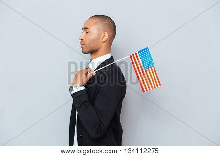 Profile of african american young man with US flag