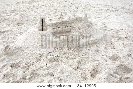 Amateur sand castle built from extremely white sand