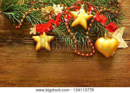 Christmas decoration red ribbon and Xmas tree on blurred wooden background