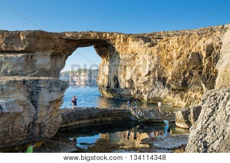 GOZO, MALTA - JUNE 6: Tourist visiting the Azure Window, a famous stone arch, on June 6, 2015 in Gozo, Malta.