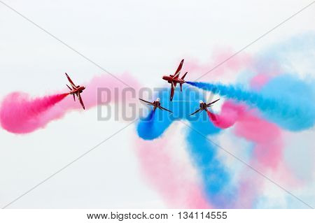 LEEUWARDEN THE NETHERLANDS - JUN 10 2016: British Red Arrows demonstration team performing during the Royal Netherlands Air Force Days