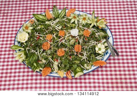 Salad With Food Carved Vegetables And Fruit