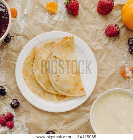 Pancakes with jam and berries. Flat Lay,