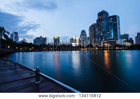 BANGKOK THAILAND - JUNE 7 2016 : view of city scape from lake park in center of bangkok