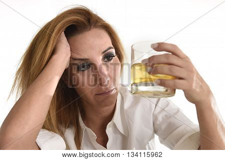 caucasian blond wasted and depressed alcoholic woman drinking scotch