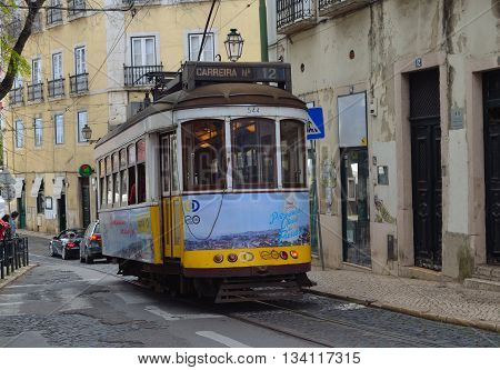 Lisbon, Portugal - March 02, 2016: Vintage Streetcar - Tram running through the old streets of the Alfama District Lisbon Portugal