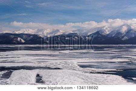 Transparent ice near the Holy Nose Peninsula. Beautiful winter landscape in the Lake Baikal.