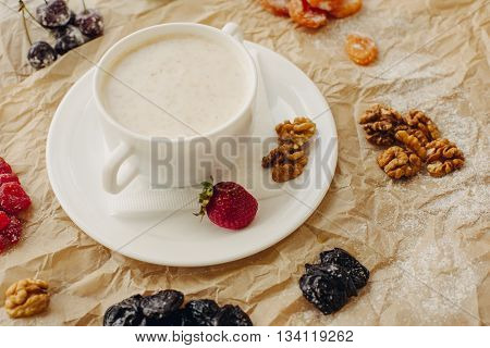 Oat meal with walnuts and berries. Parchment background