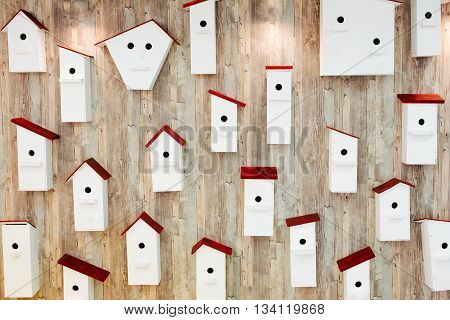 Birdhouses on the wall. Neighborhood and property concept.
