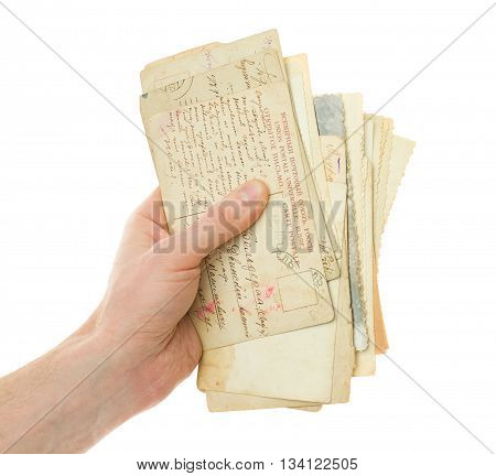 Hand with old handwriting postcard isolated on white