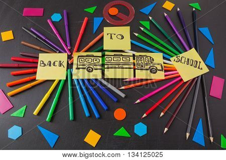 Back to school background with a lot of colorful felt-tip pens and colorful pencils in circles titles