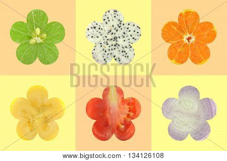 Flower shaped fruit and vegetable as a background