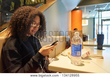 NEW YORK - CIRCA MARCH, 2016: customer in McDonald's restaurant. McDonald's is the world's largest chain of hamburger fast food restaurants, founded in the United States.