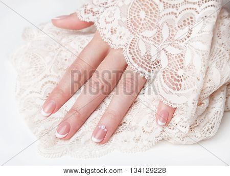 Close-up of beautiful nails with french manicure