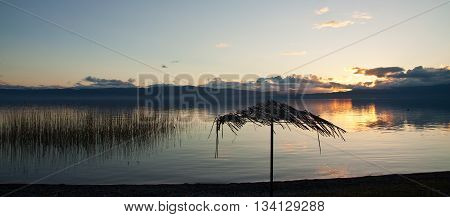 Reed umbrellas beach at the lake of Ohrid, Macedonia