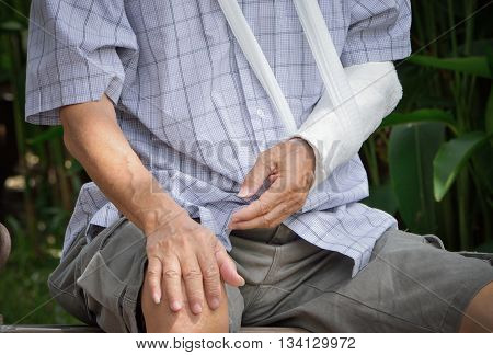 Close Up and color filler of senior patient with broken arm