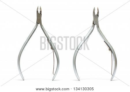 Two nail clippers for manicure on white background