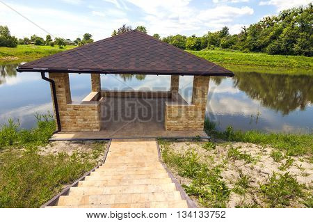 Beautiful alcove on a lake in sunny day