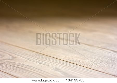 Laminate brown boards blurred background wooden texture