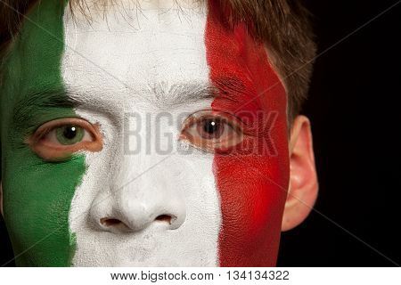 Italian fans at the stadium. Football, soccer fan. Black background