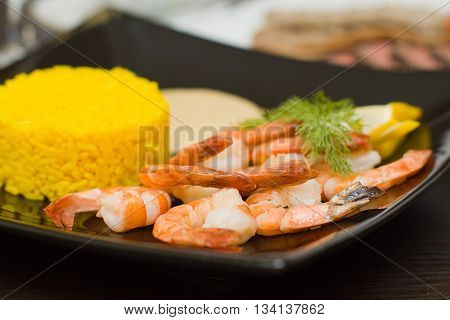 Rice and shrimps - gourmet food on black