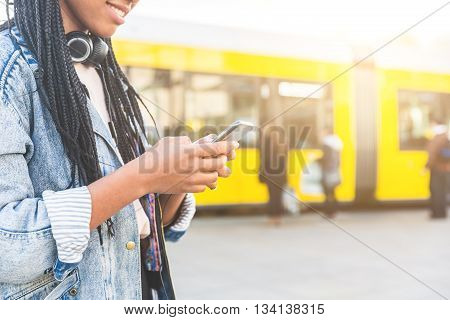 Black Young Woman Typing On Smart Phone In Berlin
