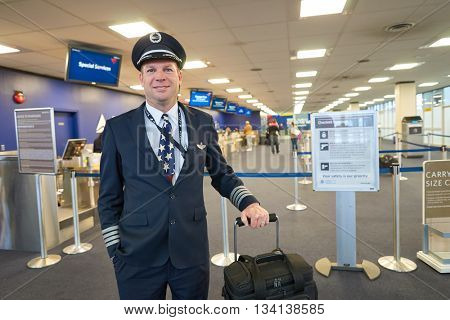 NEW YORK - MARCH 14, 2016: pilot in JFK airport. John F. Kennedy International Airport is a major international airport located in the Queens borough of New York City, United States