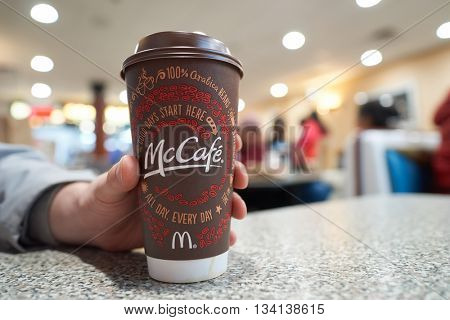 NEW YORK - CIRCA MARCH, 2016: close up shot of cup with McCafe logo. McCafe is a coffee-house-style food and drink chain, owned by McDonald's.