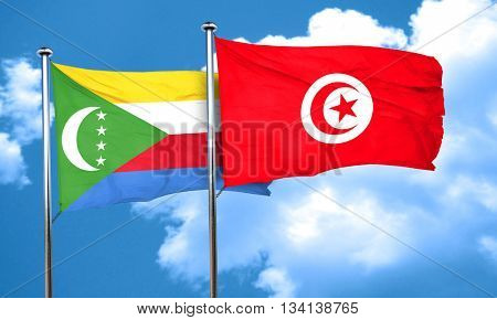 Comoros flag with Tunisia flag, 3D rendering
